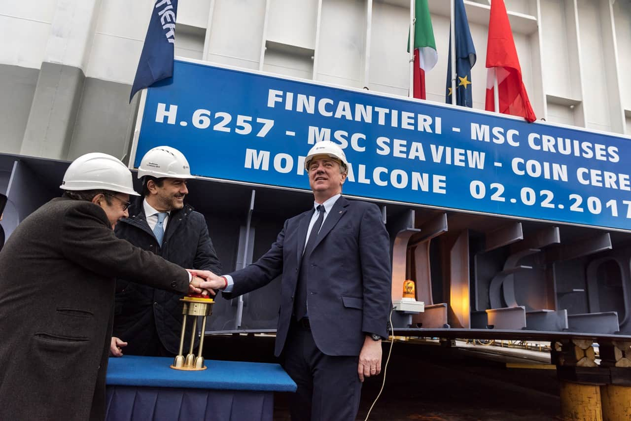 Mr Vago (Executive Chairman of MSC Cruises) Mr Onorato (CEO of MSC Cruises) and Mr Bono (CEO of Fincantieri) push the button to begin the movement of the block into the dry dock