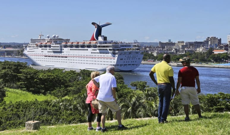 Couples watch the Carnival Paradise arrive in Havana, Cuba, for the first time Friday, June 30, 2017. It is the first time a Carnival Cruise Line ship has ported in Cuba and marks the beginning of a series of a dozen Tampa, Fla.,-to-Cuba cruises scheduled for the ship through May 3, 2018. About 2,400 passengers are aboard the 855-foot-long vessel for the inaugural voyage. (FOR EDITORIAL USE (Sven Creutzmann/Carnival Cruise Line/HO)