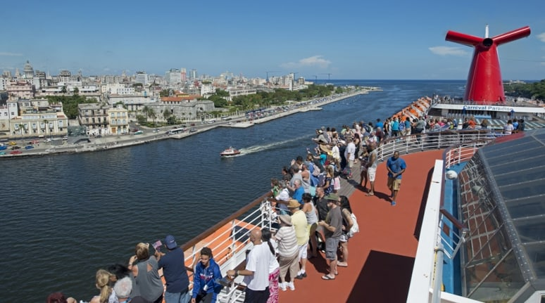 Passengers aboard the Carnival Paradise enjoy the view of Havana, Cuba, Friday, June 30, 2017. The arrival marked the first time a Carnival Cruise Line ship has ported in Cuba and heralded the beginning of a series of a dozen Tampa, Fla.,-to-Cuba cruises scheduled for the ship through May 3, 2018. About 2,400 passengers are aboard the 855-foot-long vessel for the inaugural voyage. FOR EDITORIAL USE (Andy Newman/Carnival Cruise Line/HO)