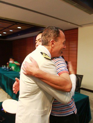 2. A representative of the rescued crew hugs and thanks Costa  Victorias ...