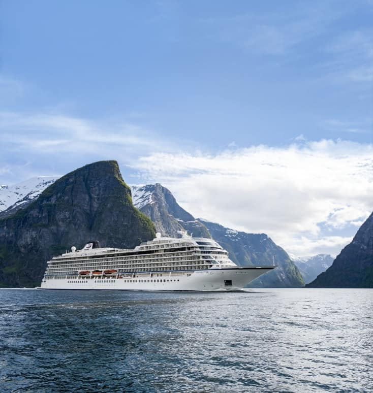 """Viking Cruises announces new """"In Search of the Northern Lights"""" itinerary exploring the far north of Norway during a peak period for aurora borealis sightings. Beginning in January 2019, the new offering establishes Viking as the first U.S. cruise line to offer a rare full-length itinerary in the Arctic Circle during the winter season. Visit www.vikingruises.com for more information. (PRNewsfoto/Viking Cruises)"""